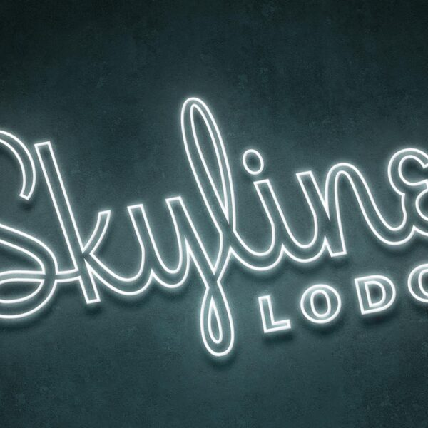 neon sign of Skyline Lodge logo