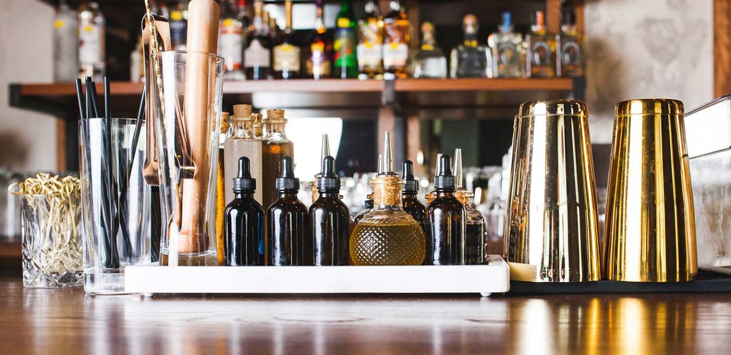 glasses, straws, and other drink tools displayed on a bar top